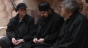 Norris Chumley listens to Fr Neilos of St Catherine's Monastery on silence with Fr John McGuckin